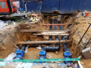Stop valves, PE large water services eased under existing networks.